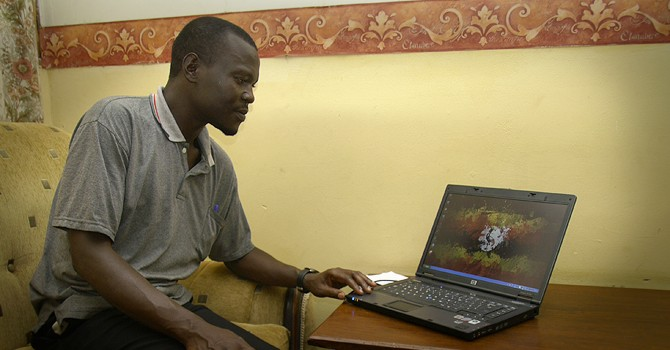 Project Manager Godfrey with his new laptop.